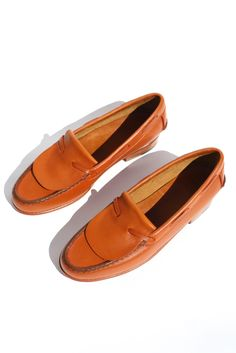 A sculptural loafer with classic elements referenced and reimagined rather  than repeated. The rounded toe with fold over vamp and threaded leather tie  detail are simplified to highlight the quality construction and design of  this step-in shoe. Finished with streamlined moc-style stitching and  half-inch rubber capped stacked leather heel. These traditional loafers are  created from a single piece of leather in a process that takes days to  complete -a shoe that lasts a lifetime and only…
