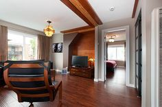 Stylish and and warm, this short-term rental suite in the heart of Vancouver's Commercial Drive neighborhood is a classy vacation option. The Neighbourhood, Photo Galleries, Classy, Warm, Mirror, Luxury, Vancouver, Commercial, Hotels