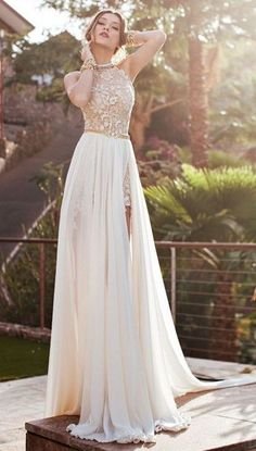convertible wedding dress with a tulle skirt and a slit on it