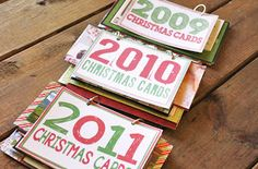 Christmas Card Books - Love this idea!  I have cards from family members who have passed that i hate to throw away.  What a wonderful way to remember all from year to year and see families grow and change.