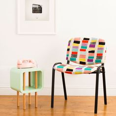 Use a staple gun and fabric to reupholster an old chair.