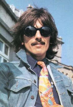 8dd590eb2950 Stylish George Harrison of the Beatles in Rounded Black Sunglasses - Rock  Legends in Sunglasses