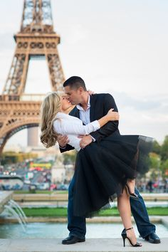 Girl in tutu dress kissing with her boyfriend in front of the Eiffel Tower in Paris. Paris photographer Fran Boloni is the author of the picture.