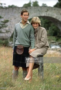 Prince Charles And Princess Diana Holding Hands And Smiling As They Pose During A Honeymoon Photocall By The River Dee. The Princess Is Wearing A Tweed Suit Designed By Bill Pashley With A Pair Of Cream Shoes From The Chelsea Cobbler.