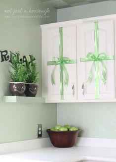 """Kitchen Christmas Decor: """"wrap"""" your cabinets like presents by adding a bow! Merry Christmas, Christmas Time Is Here, Green Christmas, Christmas And New Year, Christmas Holidays, Cheap Christmas, Christmas Ribbon, Home Design, Apartment Decorating For Couples"""
