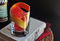 Negronez Cocktail 2 ounces gin (the Botanist used here) 1 ounce sweet vermouth (Dolin Rouge used here) 1/2 ounce Maraschino liqueur A couple dashes orange bitters Orange peel, for garnish 2 Campari ice cubes