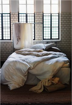 There's something about feather comforters and neutral sheets that just calls to me