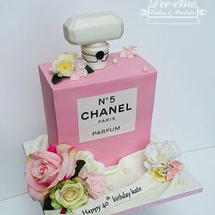 Beautiful pink Chanel bottle by @deevinecakes. See the best Edible Image Designs posted daily at http://topperoo.com/edible-image-designs/