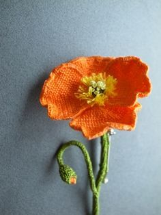 crochet - OMG! these crochet poppy flower brooches are so beautiful