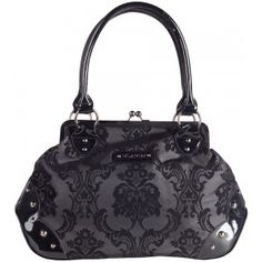 Rock Rebel introduces the Mistress Midnight handbag! This vintage inspired purse with flocked damask pattern, kisslock closure, round metal feet & sturdy handles is a must for all ghouls lookin' to head out into the moonlight.