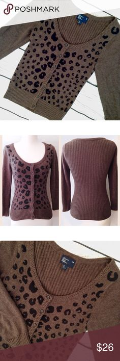 "American Eagle Leopard Printed Cardigan Luxuriously soft and warm espresso brown leopard print wool blended scoop neck cardigan sweater. Button up; lightly cropped sleeves. By American Eagle Outfitters. Size S. 95% cotton 5% wool. Chest measures 30-40"". Length 23"". Sleeve 19.5"". Good pre-owned condition with no holes, rips, or stains.  KWs: weekend warrior, total trendsetter, fall fashion, animal print, cheetah, rockabilly, pinup, indie, blogger, preppy, casual chic, edgy, layering, layers…"