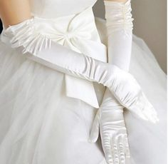 Keep it classy with this long-sleeved satin gloves! Click for more info.
