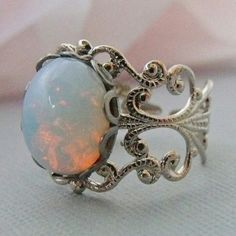 have this ring but in blackish green, wish  i had the opal, its my birthstone