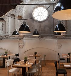 "Mercat Restaurant. Amsterdam. | ""The industrial eclectic atmosphere is inspired by  typical Spanish indoor markets, such as the world famous Mercat de La Boqueria in Barcelona. The interior is full of energy and liveliness, and definitely speaks spanish in a dutch surrounding."" 
