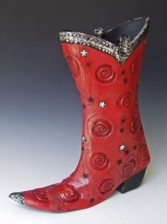 All shoes and boots are made of clay and are raku fired. Some have added materieals after the firing such as feathers or gold and silver leaf. Ceramic Shoes, Fire Clay, Ceramic Artists, Clay Art, Rubber Rain Boots, Objects, Pottery, Ceramics, Silver