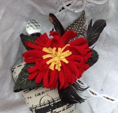 Feathers add sophistication to this beautiful hat, lapel or scarf.  This red and yellow felted wool pin adds beauty to your wardrobe. by UpcycleDesignsByDana on Etsy