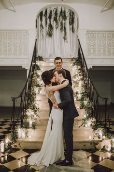 Stairs covered in greenery and candles as the ceremony backdrop = perfection | Image by Photography by Ben and Kadin