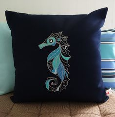 Sunbrella Indoor/Outdoor Embroidered Seahorse Pillow Cover, Navy Canvas Pillow Cover, Embroidered Seahorse Throw Pillow, Blue Pillow by OBACanvasCo on Etsy https://www.etsy.com/listing/181008058/sunbrella-indooroutdoor-embroidered