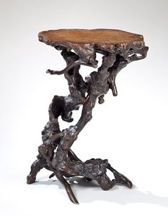 A natural elm root (?) stand of irregular twisting gnarled shape. Chinese or Japanese, 19th century. Height: 57 cm / 22 1/2 inches; Maximum width: 37 cm / 14 1/2 inches.