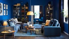 """Blue living room with display cabinets and KIVIK 2 seater sofa and chaise longue with cover """"Hillared"""" in dark blue - Decoration For Home Blue Bedroom Colors, Dark Blue Bedrooms, Bedroom Color Schemes, Blue Rooms, Blue Walls, Dark Walls, Living Room Sets Ikea, Living Room Furniture, Living Room Decor"""