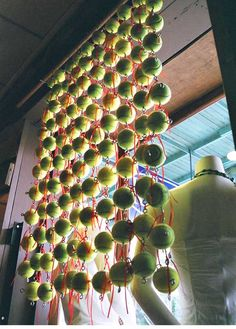 Tennis balls make up this hanging wall!
