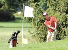 Dover's Justin Crone chips onto the 16th green at River Greens Golf Course during Wednesday's ECOL Golf Tournament. Crone shot an 80, and the Tornadoes placed second behind Marietta in the Scarlet Division.