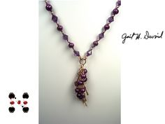 Purple necklace done with purple pearls and purple Swarovski crystals with wire wrapped pendant and gold dangles