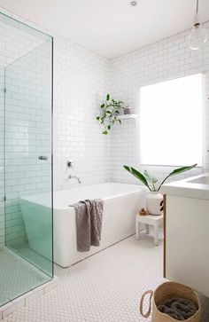 Home Renovation Bathroom Timeless bathroom design with white tiles, huge window and squared off free standing tub. 8 bathrooms that are big on style Bathroom Layout, Bathroom Colors, Bathroom Interior Design, Bathroom Ideas, Tile Layout, Bath Ideas, Bathroom Designs, Restroom Ideas, Budget Bathroom