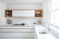 The kitchen, located at the front of the home on the lower ground floor, was fitted with bespoke oak-lined cabinetry that provides a warm contrast to the crispness of the space. Minimalist Kitchen, Minimalist Interior, Minimalist Design, British Architecture, Interior Architecture, Interior Design, Victorian Townhouse, Victorian Terrace, Oak Sideboard