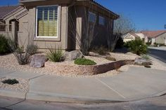 A desert southwest landscaped front yard corner lot. With Ocotillo, cactus, and other xeric and native plants, this front yard uses very little water.