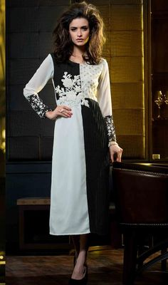 Adorn your beautiful look by wearing this off white and black color embroidered georgette tunic. This gorgeous attire is displaying some amazing embroidery done with resham and stones work. #ladiestunictop #westerntunicoline #designerkurtis
