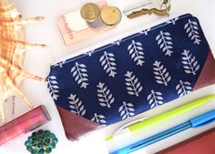 Indigo block print pouch with artificial leather accents.