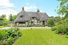 Full of period features, including ceiling beams, leaded light windows, thumb latch doors, brick floors and original oak floor boards, this Grade II Listed thatch is simply magical. Price when published: £610,000 For more info visit humberts.com.