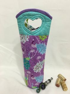 A personal favorite from my Etsy shop https://www.etsy.com/listing/464724608/peacock-wine-bag-wine-tote-quilted-tote