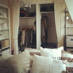 Love the idea of covering the open closet with curtains