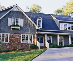Like the blue-grey siding with the red brick. This could work on our house