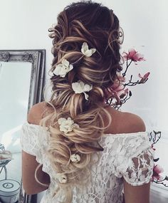 Messy braids + flowers... Will this ever get old? We think not! Image | @ulyana.aster #beautiful #love #bridalstyle #bridal #bridalfashion #bridaltrends #bridalhair #bride #bridetobe #bridetobe2017 #bridetobe2016 #white #whitewedding #gorgeous #chicbride #modernbride #bohobride