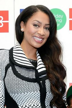 LaLa Anthony's side-swept waves make a head-turning style statement at  JCPenney's Holiday Giving Tour Kick Off At CitiPond At Bryant Park in New York City.