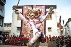 During the three-day spectacle of the Tiji Festival, monks dress as different animals, demons and divinities to enact an epic fight between good and evil. In the town square of Lo Manthang, a monk dressed as a skeleton performs an ancient dance accompanied by ceremonial Tibetan Buddhist music. (Taylor Weidman/The Vanishing Cultures Project)