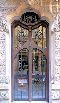 Beautiful ornate metal door ~ Barcelona, Spain