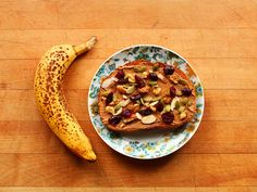 Banana and rye toast topped with peanut butter and trail mix (walnuts, pumpkin seeds, sliced almonds, and dried cranberries).