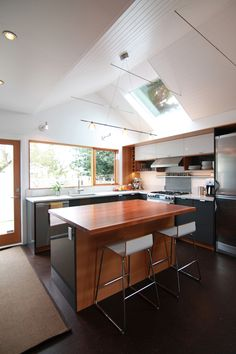The kitchen was completely reconfigured with direct visual connection the backyard. A vaulted ceiling and skylight provide ample natural light even on cloudy days.