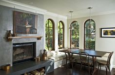 Fireplace with hearth and custom banquette - mediterranean - dining room - san francisco - Mueller Nicholls Cabinets and Construction