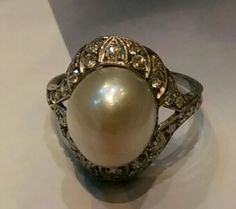 Art-Deco Natural saltwater pearl and diamond ring. Mounted in platinum. Natural Pearl 14mmX12.8mm