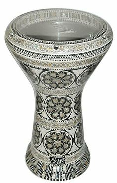 """GAWHARET EL FAN Drum Mother of Pearl Darbuka DRUM 17.5"""" by GAWHARET EL FAN. $329.00. This is a beautiful new 17.5"""" darbuka. It's the new generation of GEF drums. Higher and wider with a unique bottom finishing. Amazing Drum! Comes with a clear synthetic head and a premium case. This drum is a top quality drum! The Beautiful and intricate inlay of real mother of pearl and the beautiful patterns make this drum a real work of art. Covered with real mother of pearl that reflects ..."""