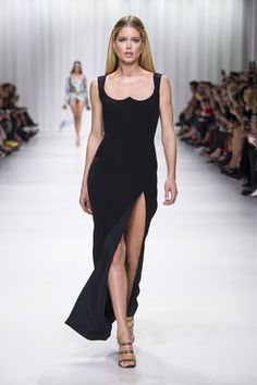The back of this black, cut-away sculpted dress is STUNNING  OMGOSH