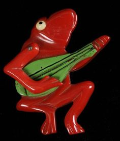 Bakelite frog playing banjo. Learn about your collectibles, antiques, valuables, and vintage items from licensed appraisers, auctioneers, and experts at BlueVault. Visit:  http://www.BlueVaultSecure.com/roadshow-events.php