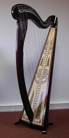 This is a beautifully painted Melusine de Concert from Camac Harps with a Hi Gloss finish. This harp is Camac's Concert Celtic harp. It comes plain in many finishes and special orders. When mine arrives I will give and update on its sound.