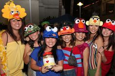 DIY Sesame Street Costumes.  We bought trucker hats from the thrift store.  All you need is a hot glue gun, felt, foam balls, cardboard, and fabric.  It was a cute way to dress up without wearing a mask or bulky costume.  :)