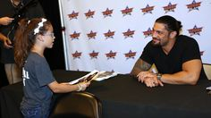 Roman Reigns and Seth Rollins host  a VIP signing at the Barclays Center in NYC